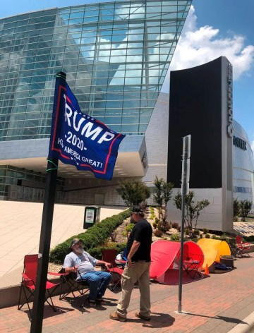 James Massery, left, of Preston, Okla., and Daniel Hedman, of Tulsa, Okla., supporters of President Donald Trump, camp outside the BOK Center in Tulsa on Tuesday, June 16, 2020, four days before his scheduled rally Saturday.
