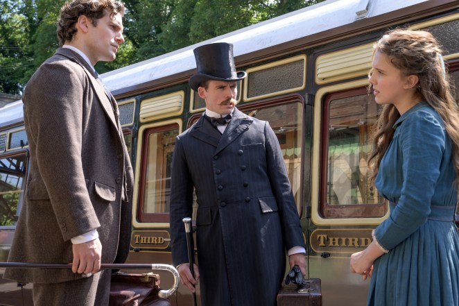 """Enola (Millie Bobby Brown) reconnects with older brothers Sherlock (Henry Cavill, left) and Mycroft (Sam Claflin) in """"Enola Holmes."""""""