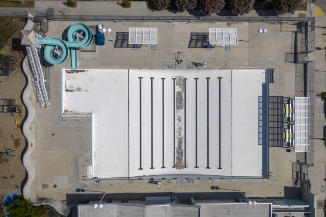 An aerial view shows the empty Hollywood Pool as Los Angeles County allows more businesses and facilities to reopen today, despite rising COVID-19 infections and deaths on June 12, 2020 in Los Angeles, Calif. After reporting the largest single-day jump in coronavirus cases, health officials are warning that the county's transmission rate of the disease could overwhelm intensive-care units in the next two to four weeks if the increase isn't reversed. Newly allowed reopenings include gyms and fitness facilities, spectator-free sports venues, day camps, museums, galleries, zoos, aquariums, campgrounds, RV parks, outdoor recreational areas including swimming pools, music, film and television production and hotels for leisure travel. The county's death toll is currently more than 2,800 with the total number of cases nearing 69,000.