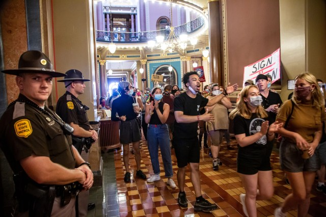 Matthew Bruce leads a group of Black Lives Matter activists at the Iowa State Capitol on June 29, 2020, calling for Gov. Kim Reynolds to sign an executive order to allow felons in Iowa to vote.
