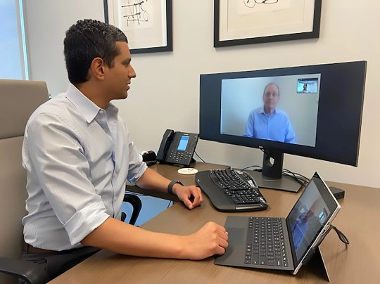 Dr. Christopher Ramos, a gastroenterologist with Texas Digestive Disease Consultants, meets with a patient through telehealth Wednesday.