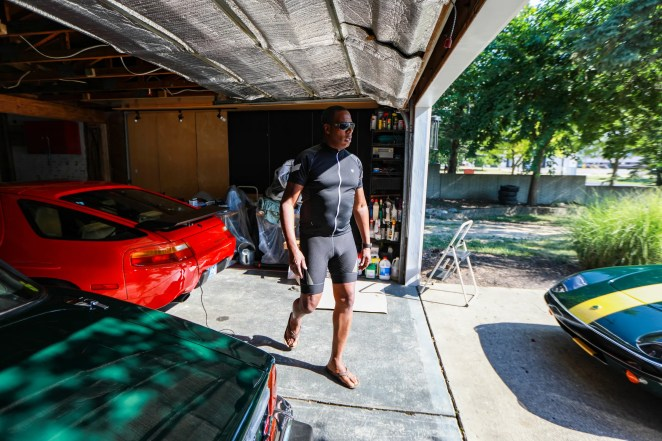 Chris Young, 48, of Southfield is a designer at Ford Motor Company where he is the User Integration Strategy lead and designed the new Ford Bronco Sport. Young walks among his collection of classic cars on July 7, 2020.