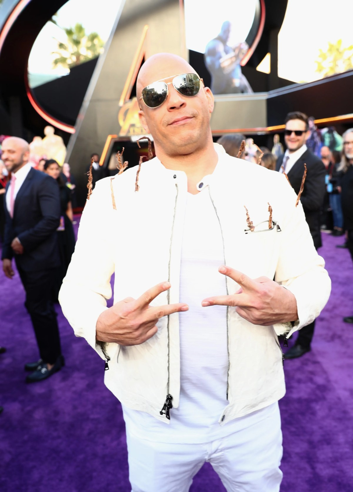 """The shades are on, and the peace signs are out! Vin Diesel attends the Los Angeles premiere of Marvel's """"Avengers: Infinity War"""" in 2018."""