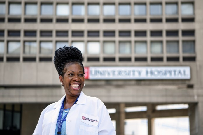 Dr. Paige Long Sharps is currently the Physician Advisor at University Hospital in Newark, NJ. Long Sharps was also an OB-GYN for almost 22 years at Montefiore Medical Center in Bronx, NY. Long Sharps poses for a photo at University Medical Center in Newark, NJ on Tuesday July 22, 2020.