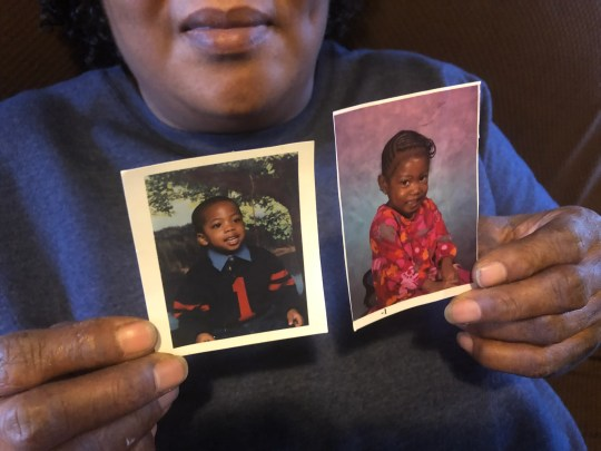 Barbara Profit holds up photos of her children Tyllis and Shirley from when they were younger. Both were diagnosed with serious disabilities at a young age.