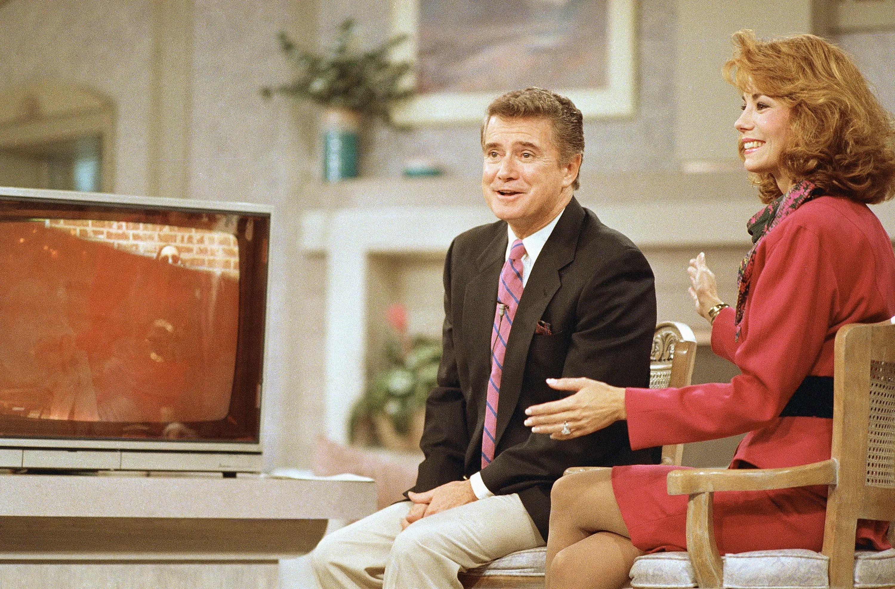 """Regis Philbin and Kathie Lee Gifford react during a WABC-TV broadcast of """"Live! With Regis and Kathie Lee"""" on Sept. 8, 1988, in New York."""