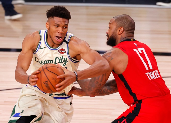 Aug. 2: Bucks forward Giannis Antetokounmpo tries to drive against Rockets defender P.J. Tucker.