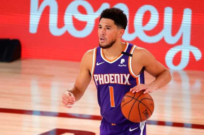 Aug 4, 2020; Lake Buena Vista, USA; Devin Booker #1 of the Phoenix Suns dribbles downcourt during the game against the LA Clippers at The Arena at ESPN Wide World Of Sports Complex on August 04, 2020 in Lake Buena Vista, Florida. Mandatory Credit: Kevin C. Cox/Pool Photo via USA TODAY Sports