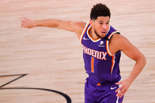 Aug 4, 2020; Lake Buena Vista, USA; Devin Booker #1 of the Phoenix Suns celebrates after hitting a three point shot against the LA Clippers at The Arena at ESPN Wide World Of Sports Complex on August 04, 2020 in Lake Buena Vista, Florida. Mandatory Credit: Kevin C. Cox/Pool Photo via USA TODAY Sports