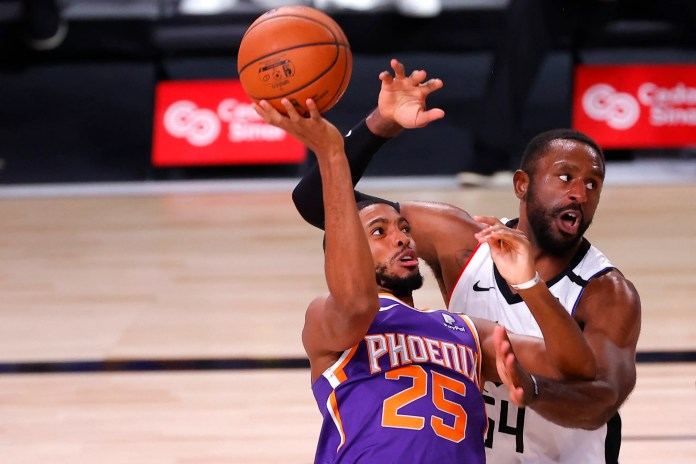 Aug. 4: Patrick Patterson of the LA Clippers defends a shot from the Phoenix Suns' Mikal Bridges. The Suns won the game, 117-115.