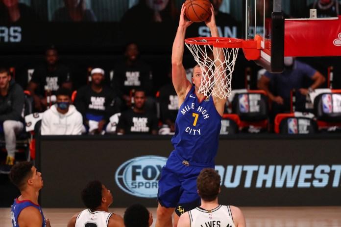 Aug. 5: Denver Nuggets forward Mason Plumlee dunks against the San Antonio Spurs.