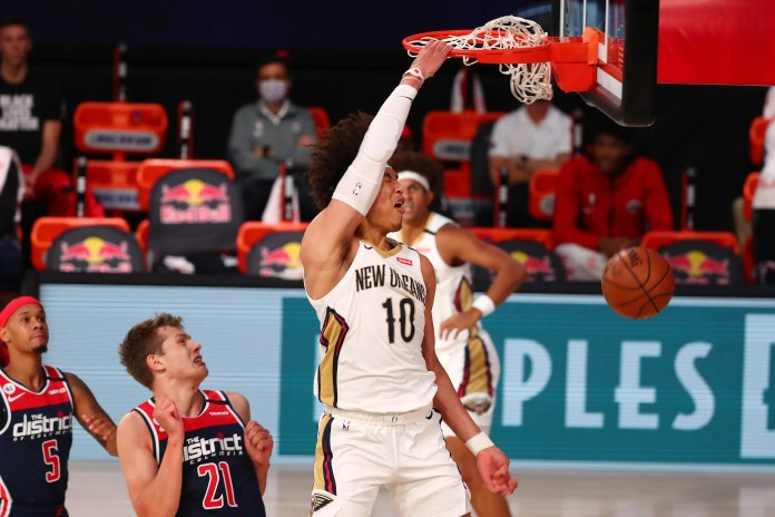 Aug. 7: Pelicans center Jaxson Hayes throws down the one-handed slam against the Wizards.