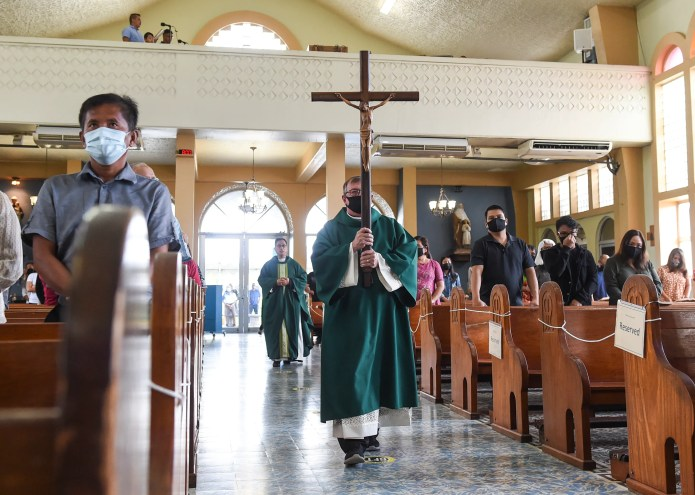 A Mass at Our Lady of Lourdes Catholic Church is shown in this Aug. 9 file photo. The Archdiocese of Agana announced a parishioner of Our Lady of Lourdes Catholic Church in Yigo tested positive for COVID-19.