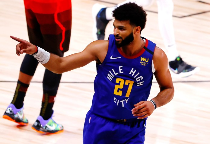 Aug. 8: Nuggets guard Jamal Murray celebrates after sinking a clutch 3-pointer against the Jazz.