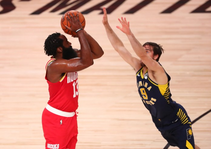 Aug. 12: Rockets guard James Harden (13) shoots over Pacers defender T.J. McConnell (9).