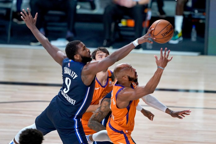 Aug. 13: The Dallas Mavericks' Michael Kidd-Gilchrist knocks the ball away from the Phoenix Suns' Jevon Carter. The Suns won the game, 128-102.
