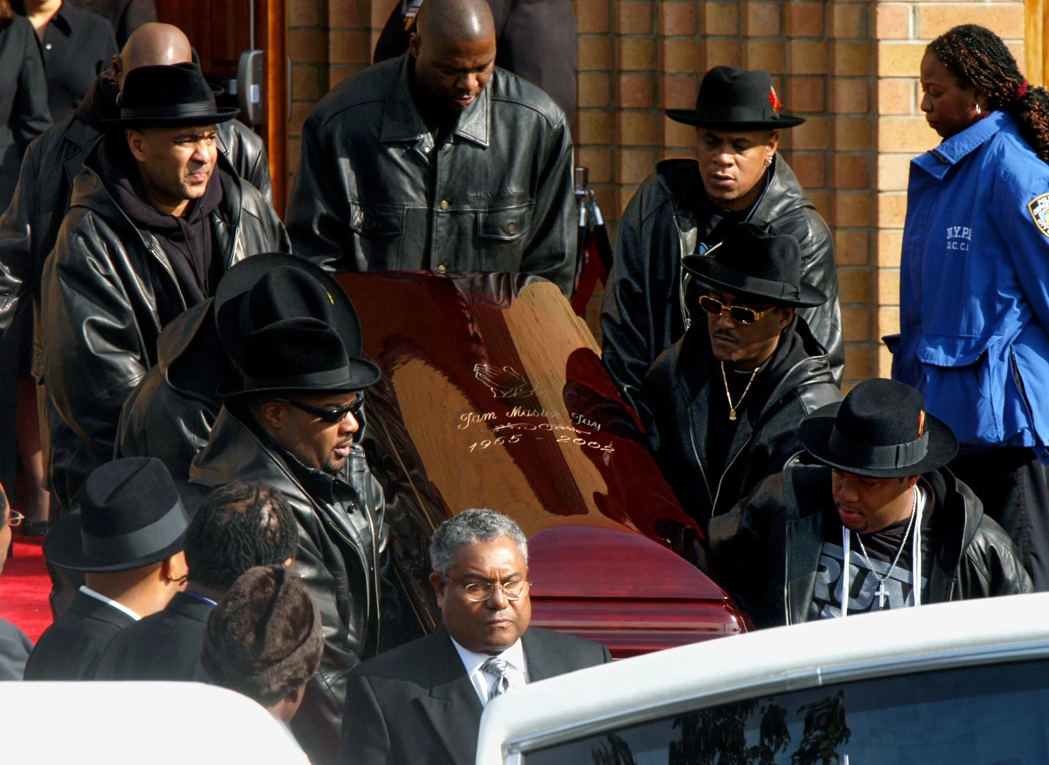 "Jason ""Jam Master Jay"" Mizell's coffin is carried out after his funeral on Nov. 5, 2002."