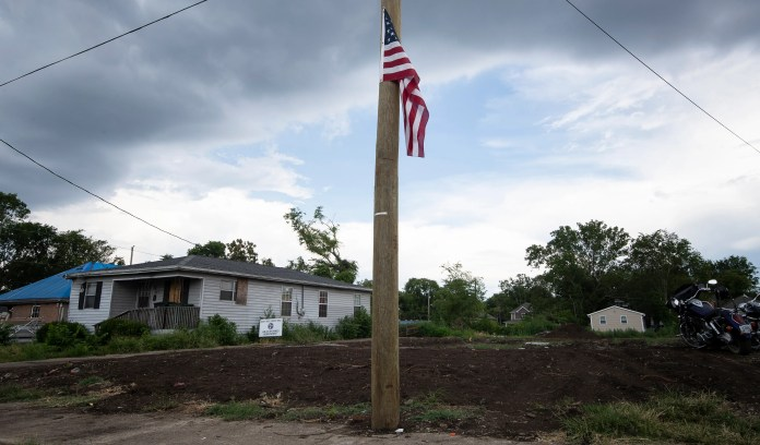 An American flag flies on a utility pole at Sam Brown's homesite Wednesday, July 22, 2020 in Nashville, Tenn. A tornado ripped through the North Nashville neighborhood March 3, 2020 demolishing homes early that morning.