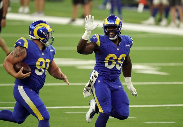 Los Angeles Rams defensive linemen Greg Gaines (91) and Sebastian Joseph-Day (69) celebrate during a scrimmage at SoFi Stadium.