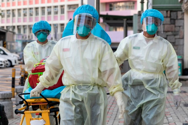 Medical staff wearing personal protective equipment as a precautionary measure against the COVID-19 coronavirus approach Lei Muk Shue care home in Hong Kong on Aug. 23, 2020.