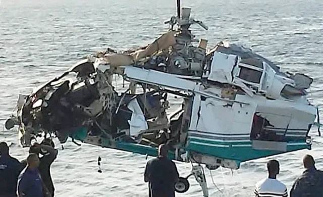 View of the 15-passenger Agusta SpA AW139 helicopter that was pulled from the ocean over the weekend. After a delay forced by bad weather and rough seas, the barge left late Saturday night for Jacksonville. [Photos by LA photography/ Special to The Palm Beach Post]