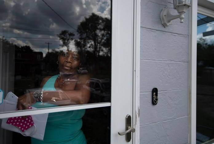 Tracey Watkins looks out the door of her home Tuesday, Aug. 25, 2020 Nashville, Tenn. While trying to repair her home after the March 3 tornado, Watkins has had to navigate financial hurdles, like fighting with her insurance company to cover repair costs.