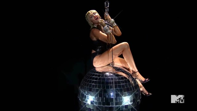 "Miley Cyrus re-creates her iconic ""Wrecking Ball"" video during the ""Midnight Sky"" performance."
