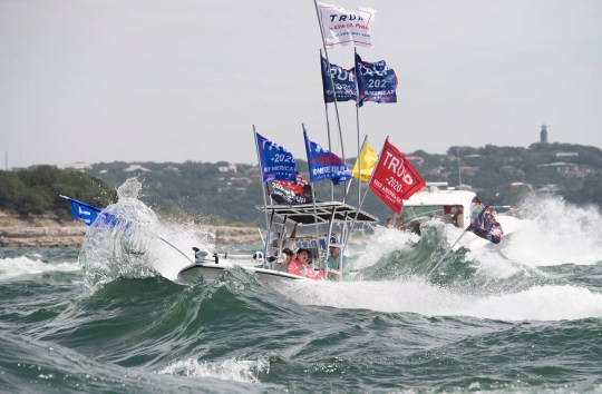Boats plow through high wake from larger crafts in a parade honoring President Donald Trump crowd Lake Travis Saturday September 5.