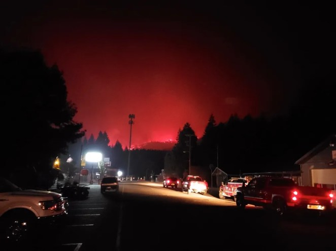 Wildfire glows in the mountains above Detroit as mandatory evacuations for the town and area came down Sept. 8, 2020.