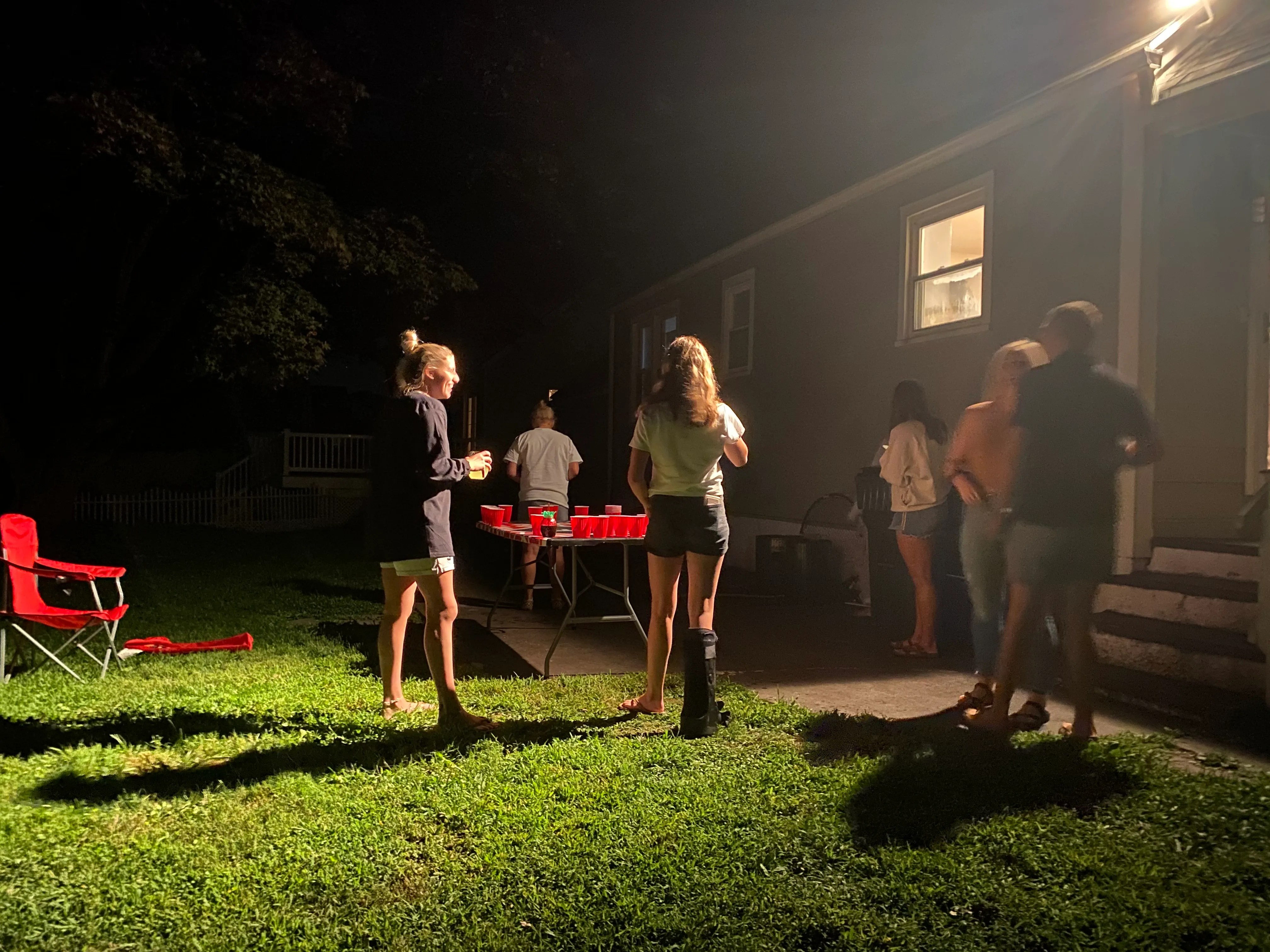 People congregate Friday at a party near the Fairfield University campus in Connecticut.