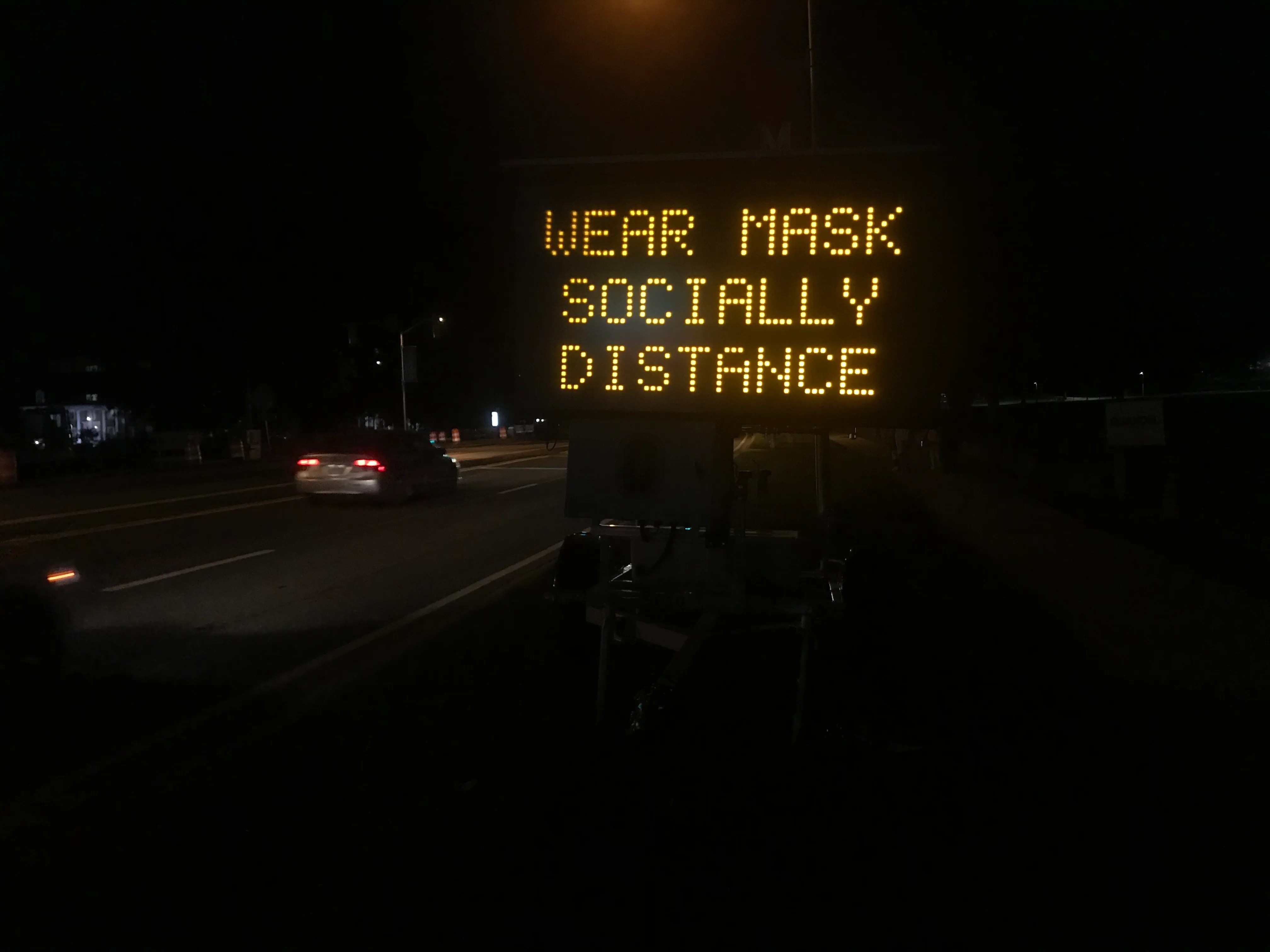 A sign near the University of Maryland campus encourages social distancing on Saturday night.