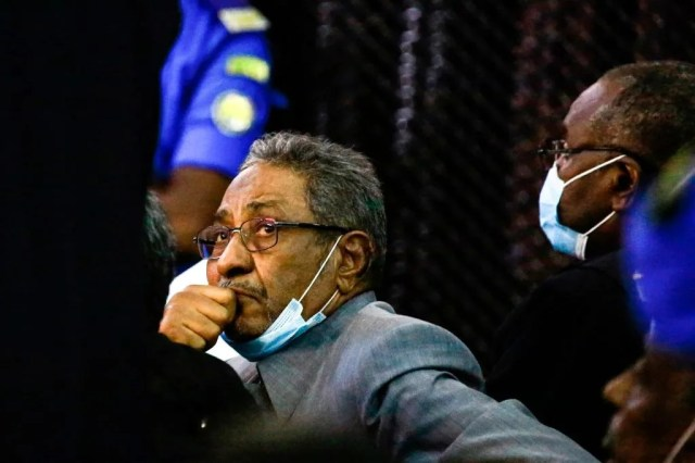 Abdul Basset Sebdarat (L), a prominent former Sudanese minister and currently lawyer for ousted president Omar al-Bashir and the 27 co-accused, attends the trial at the Khartoum courthouse in the Sudanese capital, on July 21, 2020.