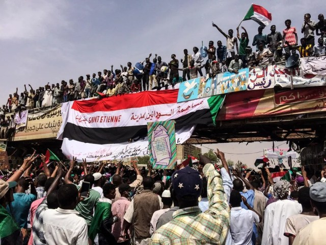 In this April 12, 2019 file photo, demonstrators chant slogans during a protest in Khartoum. Sudan's uprising has ushered in a new era both for the nation and for Sudanese women after three decades of autocratic rule by Omar al-Bashir. Sudanese women played a pivotal role in the protests that brought down al-Bashir, and under a joint military-civilian council in power now, they hope for more freedom and equality.