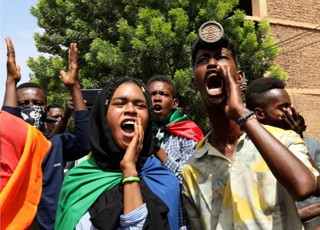 Sudanese protesters gather outside the Cabinet's headquarters in the capital, Khartoum, Sudan, Monday, Aug. 17, 2020. Protesters returned to the streets Monday to pressure transitional authorities for more reforms, a year after a power-sharing deal between the pro-democracy movement and the generals.