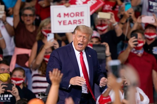 President Donald Trump reacts to supporters as he arrives to speak at a campaign rally Tuesday, Sept. 8, 2020, in Winston-Salem, N.C.