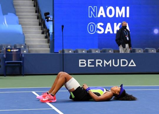 Naomi Osaka lays down on the Arthur Ashe Stadium court after beating Victoria Azarenka to win the U.S. Open.