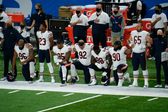 Chicago Bears' Akiem Hicks (96); Kyle Fuller (23); Roy Robertson-Harris (95), Brent Urban (92); Bilal Nichols (98); John Jenkins (90) and Cody Whitehair (65) listen during the national anthem before an NFL football game against the Detroit Lions in Detroit, Sunday, Sept. 13, 2020.