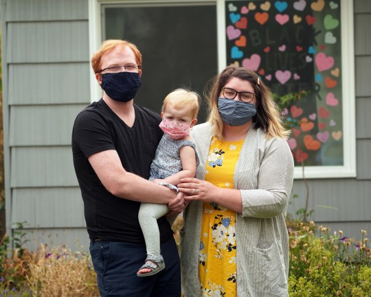 Betty Stevens, right, poses with her husband, Fred Andrews, and their daughter Eleanor outside a friend's house in Medford, Oregon, several days after losing their home in the Almeda wildfire.