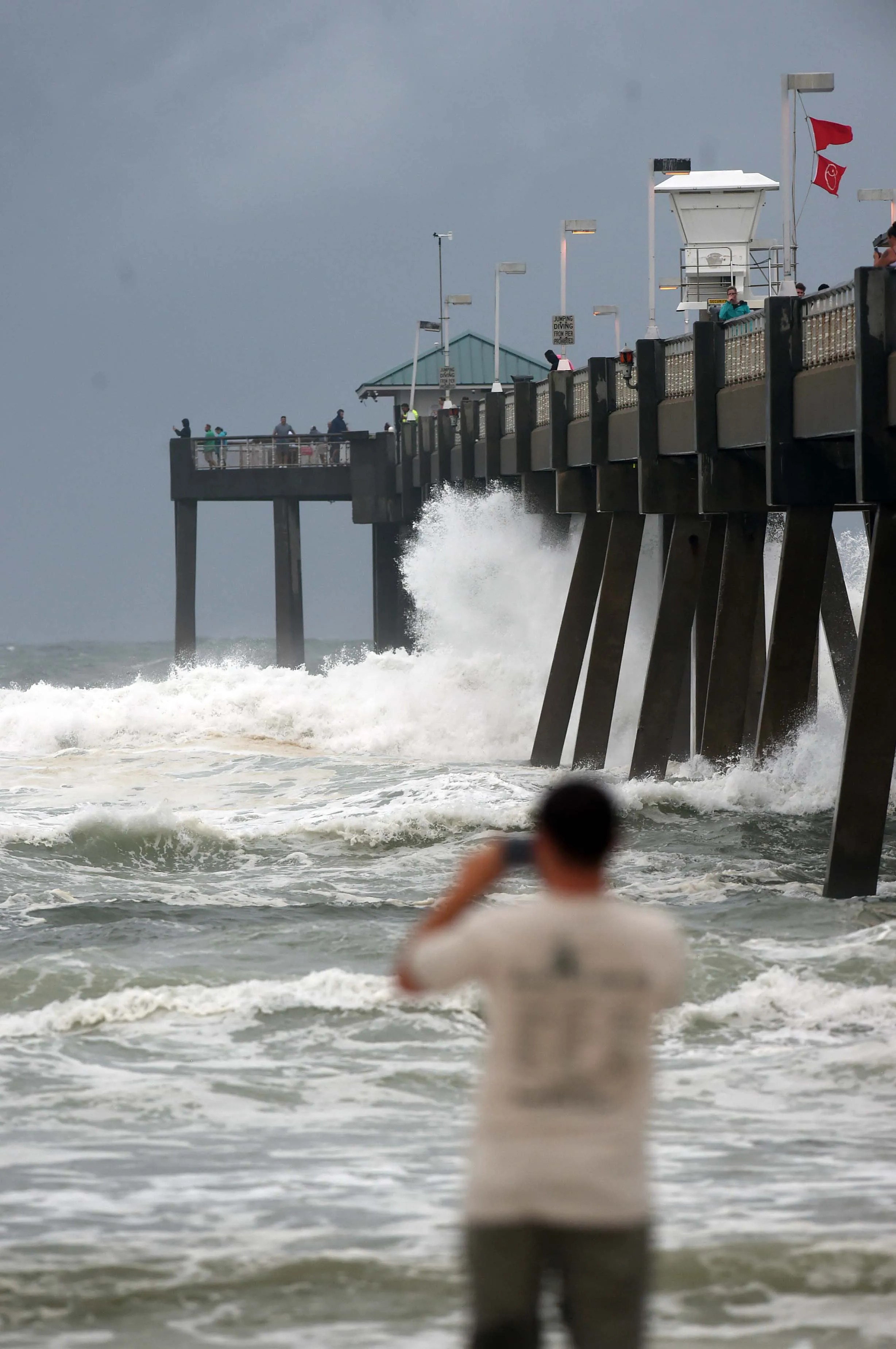Waves crash against the Okaloosa Island Fishing pier Monday evening as wind and waves from Hurricane Sally begin to brush the Emerald Coast.