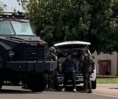 Police say a man barricaded himself in someone else's Scottsdale home following a car crash near McKellips and Scottsdale roads on Sept. 21, 2020.