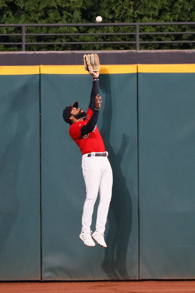 Cleveland Indians' Delino DeShields makes a leaping catch to get out Chicago White Sox's Tim Anderson during the ninth inning of a baseball game, Monday, Sept. 21, 2020, in Cleveland. (AP Photo/Ron Schwane)