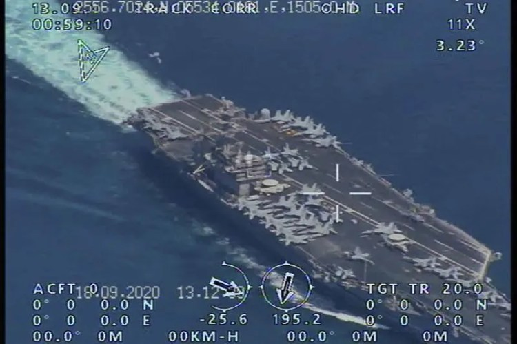 This photo released by the official website of the Iranian Revolutionary Guard on Wednesday, Sept. 23, 2020 is said to show the USS Nimitz Aircraft carrier prior to entering the strategic Strait of Hormuz and Persian Gulf. Iran's powerful Revolutionary Guard force has managed to fly a surveillance drone over the USS Nimitz aircraft carrier which last week transited through the Strait of Hormuz, the semi-official Tasnim news agency said Wednesday.