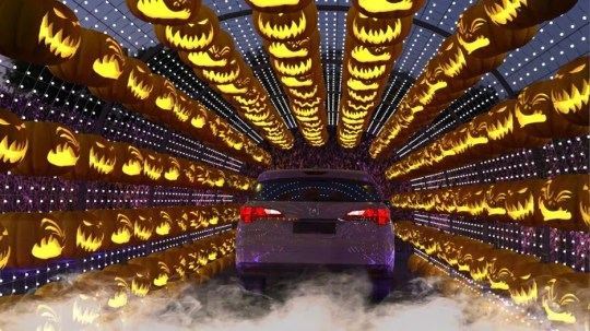 A tunnel kicked off Haunt 'O Ween, a drive-thru that had seemingly random decorations bit did give away pumpkins in Woodland Hills.
