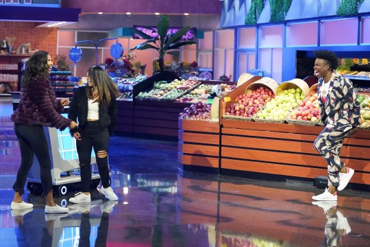 """Host Leslie Jones, right, is having a good time as she engages with contestants on ABC's revival of """"Supermarket Sweep."""""""