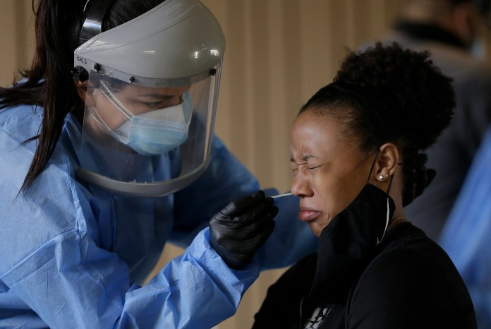 Sasha Jacquez tests UTEP student Ariona Gill for the coronavirus Friday, Oct. 16, 2020, at the UTEP Fox Fine Arts Center.