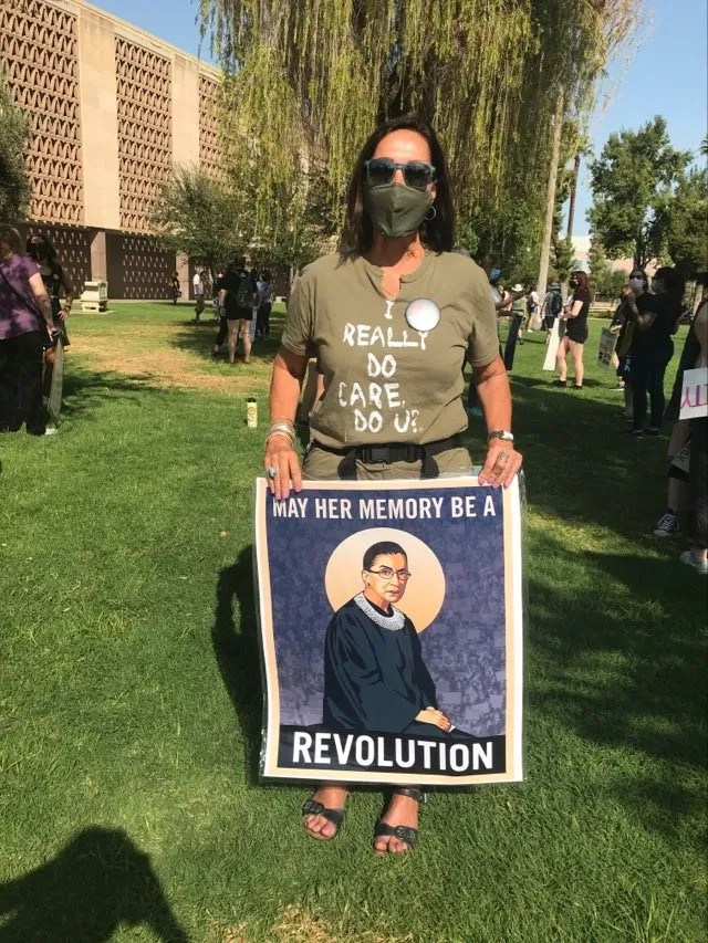 Kathryn Michael holds up her sign honoring late Supreme Court Justice Ruth Bader Ginsburg while at the Arizona Capitol lawn on Oct. 17, 2020.