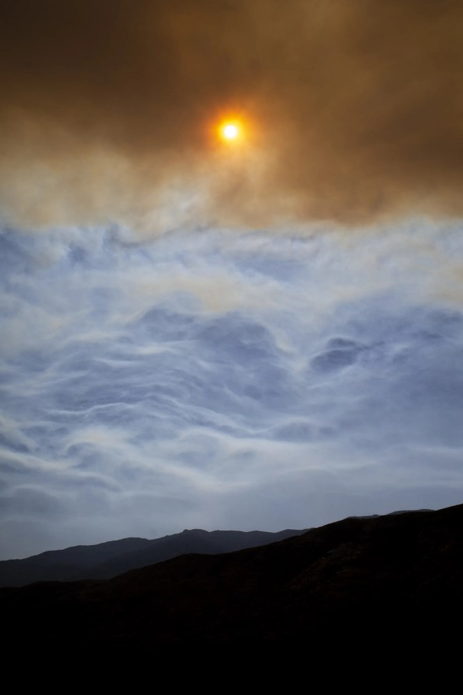 Smoke from the Horse Fire burning northwest of the community of Crown King causes the sun to appear red on Oct. 16, 2020. The residents of Crown King were forced to evacuate the morning of the 16th as the fire grew larger.