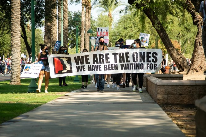 Eva Burche leads the fourth annual Women's March around the Arizona Capitol on Oct. 17, 2020.