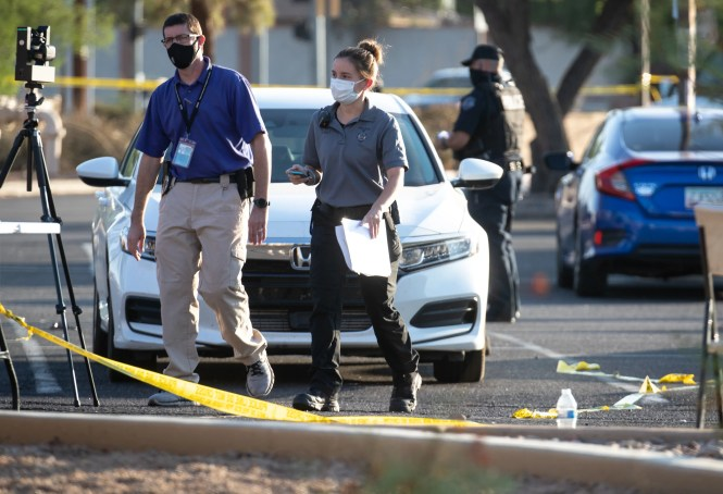Mesa Police investigate a multiple shooting, Oct. 17, 2020, in a parking lot near Dobson and Guadalupe Roads, Mesa. At least five people were shot during an incident on Friday evening.