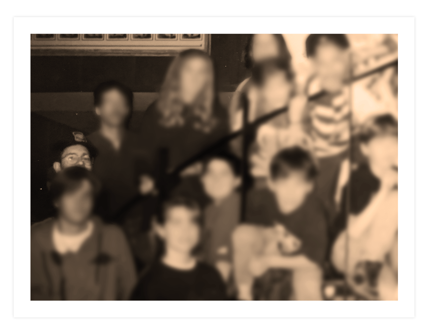 In many group photos taken through the years, David Menna appears in the back, all but obscured by one of the youths.